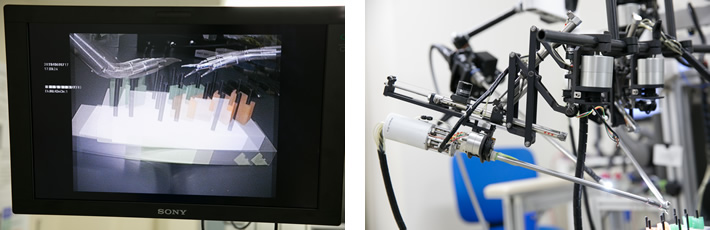 (左)モニターは3D対応で裸眼では像がダブって見える。(右)鉗子を取り付けるアームの先端。この動きを空気の力で精密に制御する。